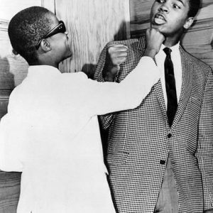 Stevie Wonder goofing around with Muhammad Ali at The Apollo Harlem 1963